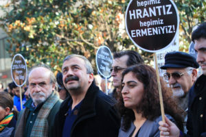 "Peoplesí Democratic Party (HDP) co-chair Sebahat Tuncel (2nd R), Mersin MP Ertugrul Kurkcu (L), and Istanbul MP Sirri Sureyya Onder (2nd L) march with other demonstrators to the offices of Armenian newspaper ""Agos"" during a commemoration ceremony for slain journalist Hrant Dink, in Istanbul, on January 19, 2014. Turkish riot police were out in force on Sunday as large crowds massed in Istanbul to demand justice for a prominent Turkish Armenian journalist murdered seven years ago. Hrant Dink, one of the most prominent voices of Turkey's shrinking Armenian community, was killed by a gunman on January 19, 2007. The 52-year-old Dink, a prominent member of Turkey's tiny Armenian community, campaigned for reconciliation but was hated by Turkish nationalists for calling the World War I massacres of Armenians a genocide. AFP PHOTO / MIRA / AFP PHOTO / MIRA"